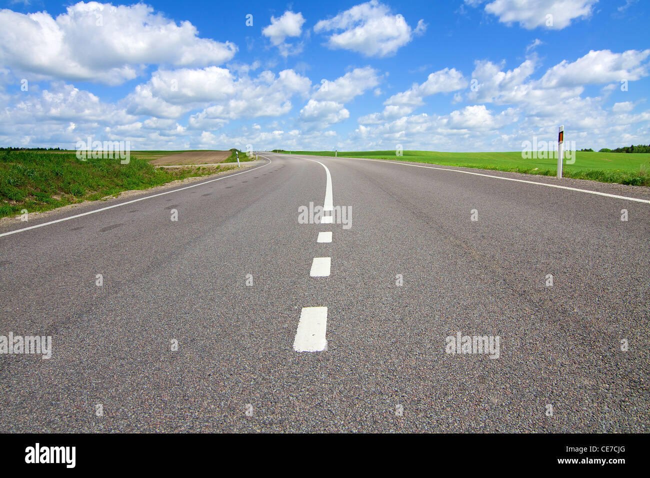 Long road stretching out into the distance Stock Photo