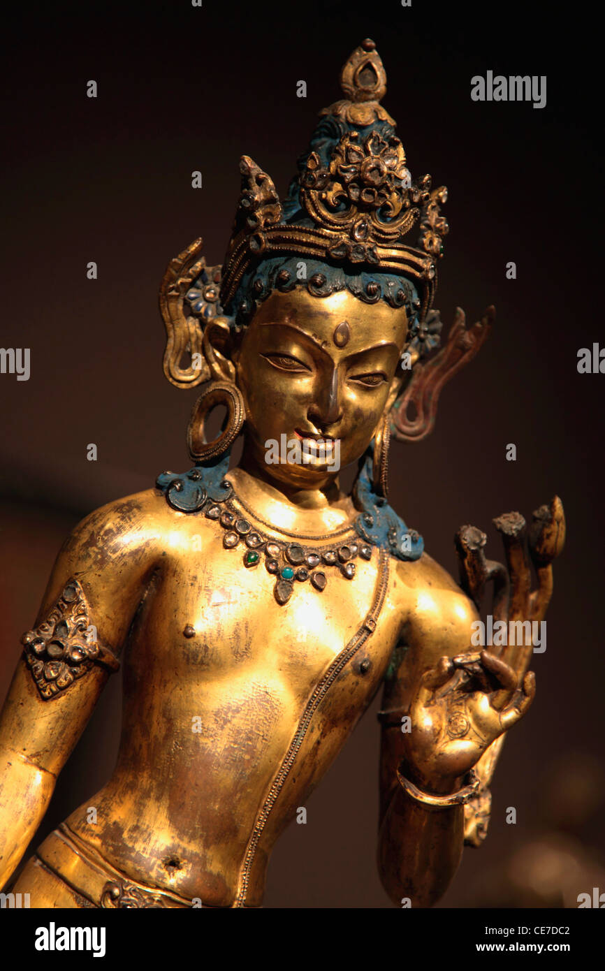 USA, California, Pasadena, A 13th century gilt-copper alloy statue of Bodhisattva from Nepal display in Norton Simon - Stock Image