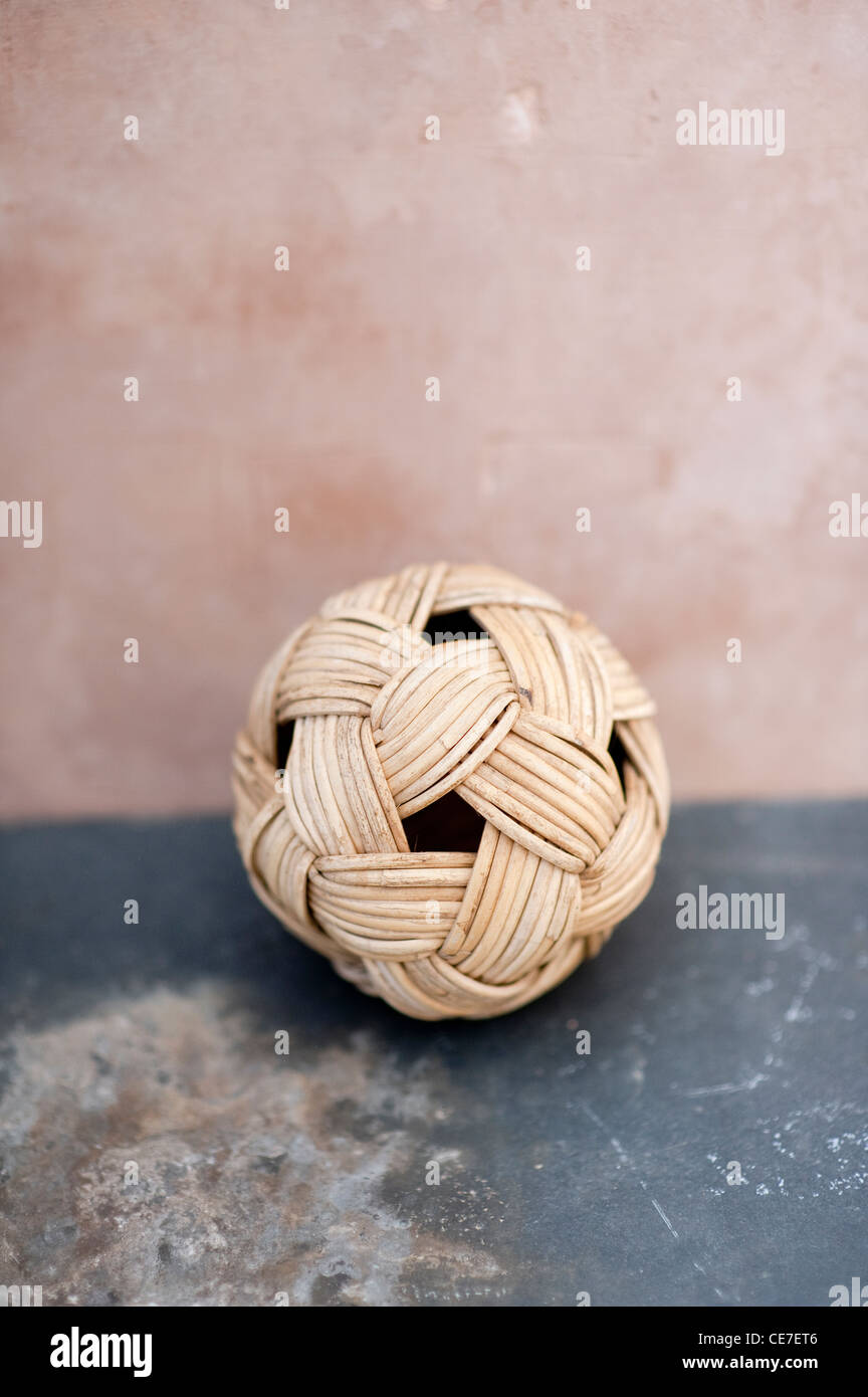 Woven ball of organic fibers on time worn surfaces. - Stock Image