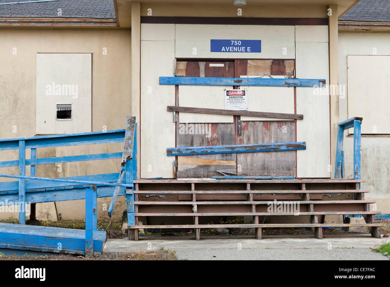 Condemned building due to asbestos contamination - Stock Image