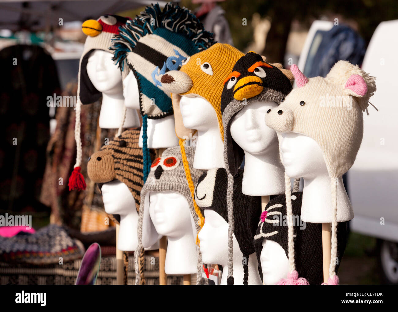 Character trapper hats for sale at flea market - Stock Image