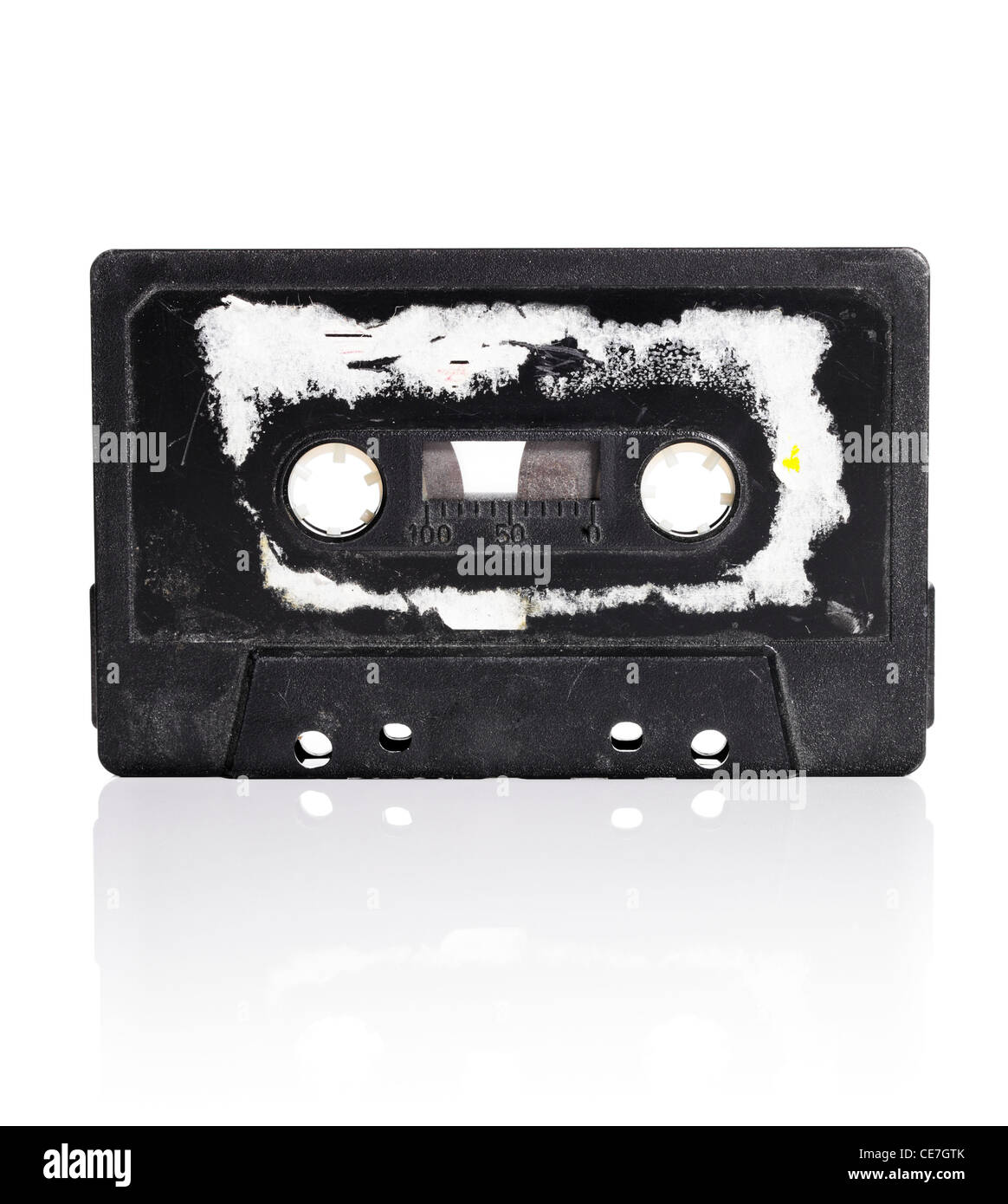 Old compact cassette audio tape with torn label - Stock Image