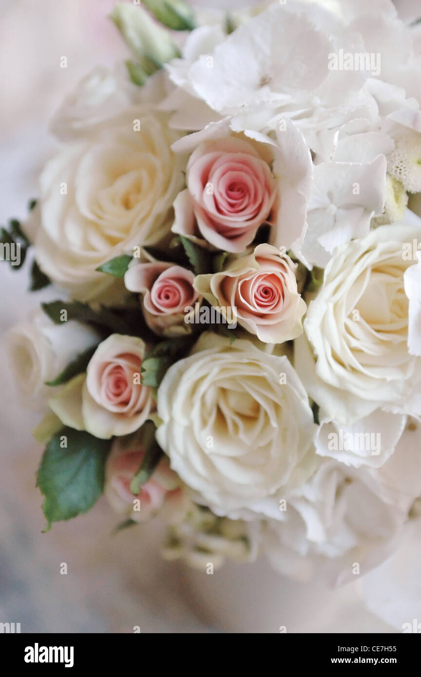 Wedding bouquet of white roses closeup. Small depth of field - Stock Image