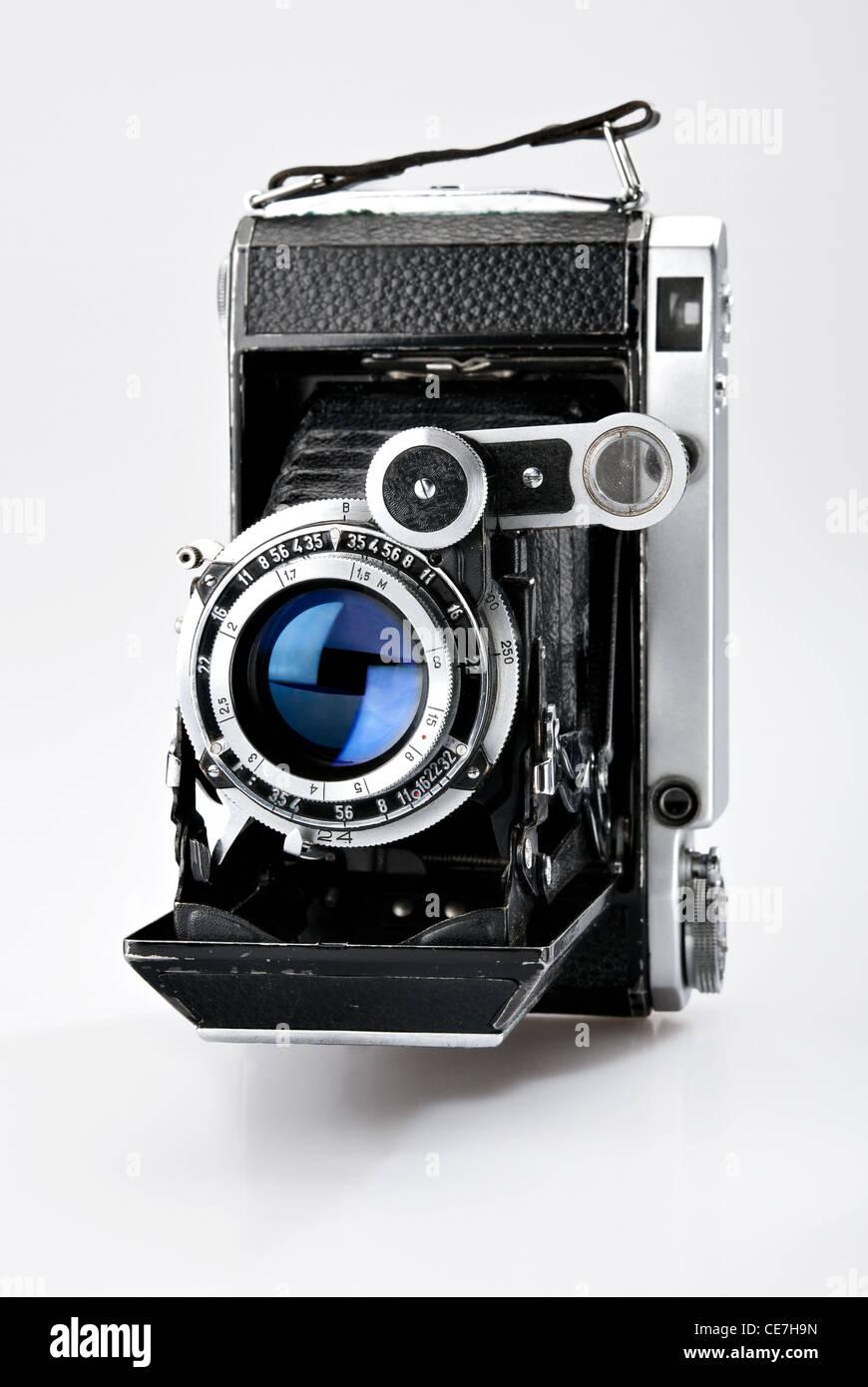 Old vintage photo camera isolated on white background - Stock Image