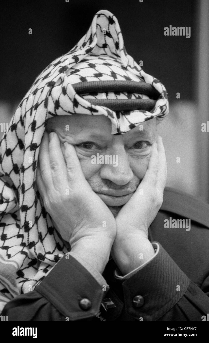 Palestinian leader yasser arafat wearing his famous black and white checked keffiyeh at his ramallah compound february 2002