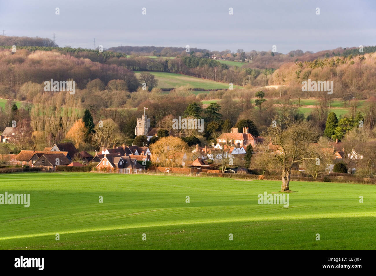 Chiltern Hills - view of  Little Missenden village - across the fields - winter - afternoon sunlight and shadows - Stock Image