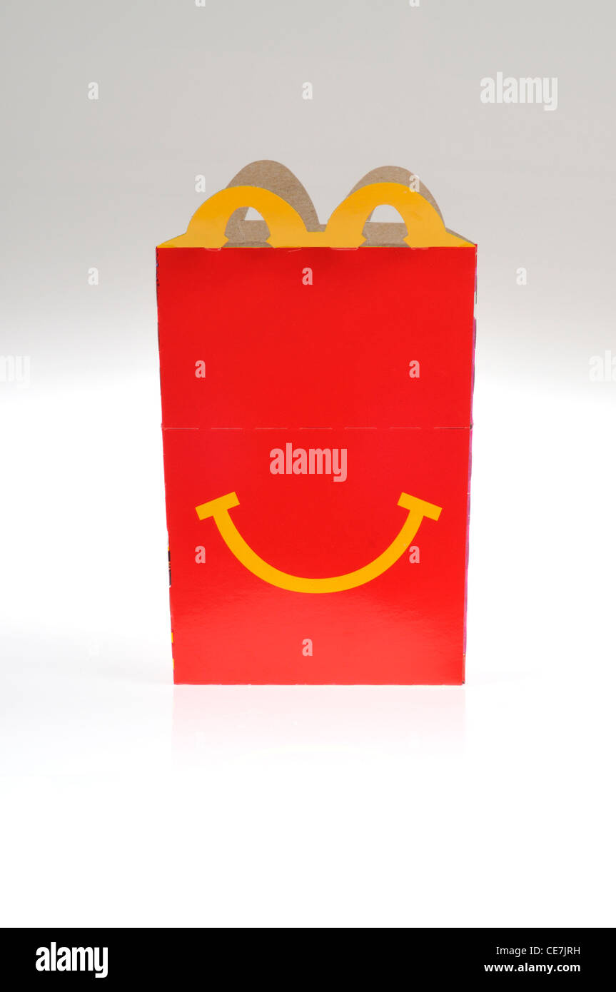 McDonald's Happy Meal packaging on white background cutout. USA - Stock Image