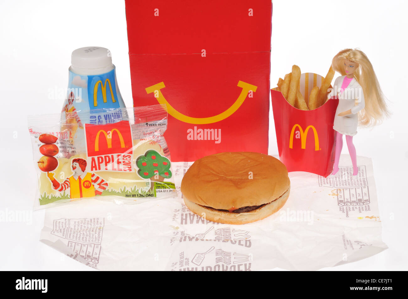 McDoanld's Girls Happy Meal with a hamburger, french fries, milk and apple dippers, a Barbie doll toy & - Stock Image