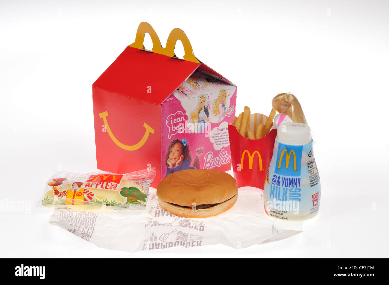 McDonald's Barbie Happy Meal with hamburger, french fries, milk  and apple dippers on white background cutout - Stock Image