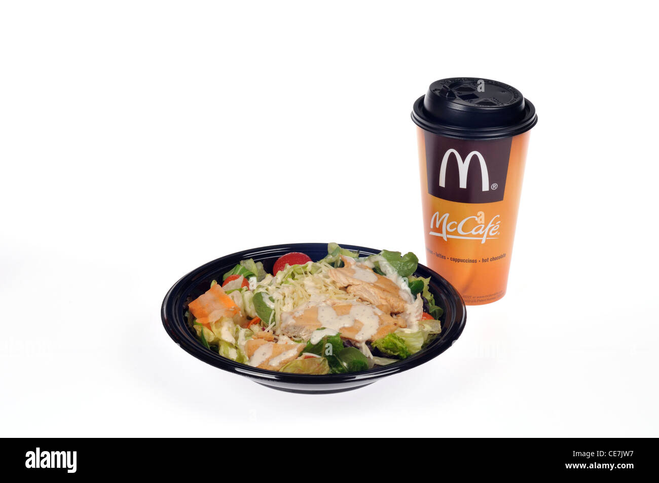 McDonalds grilled chicken caesar salad with a cup of McCafe hot coffee on white background cutout. - Stock Image