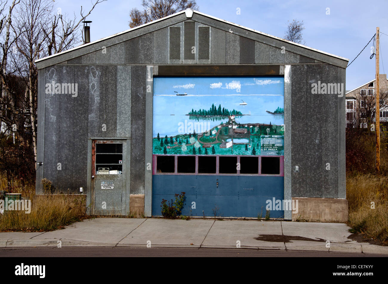 Lyle Saethre mural in Grand Marais, Minnesota, an art colony on the North Shore along Lake Superior - Stock Image