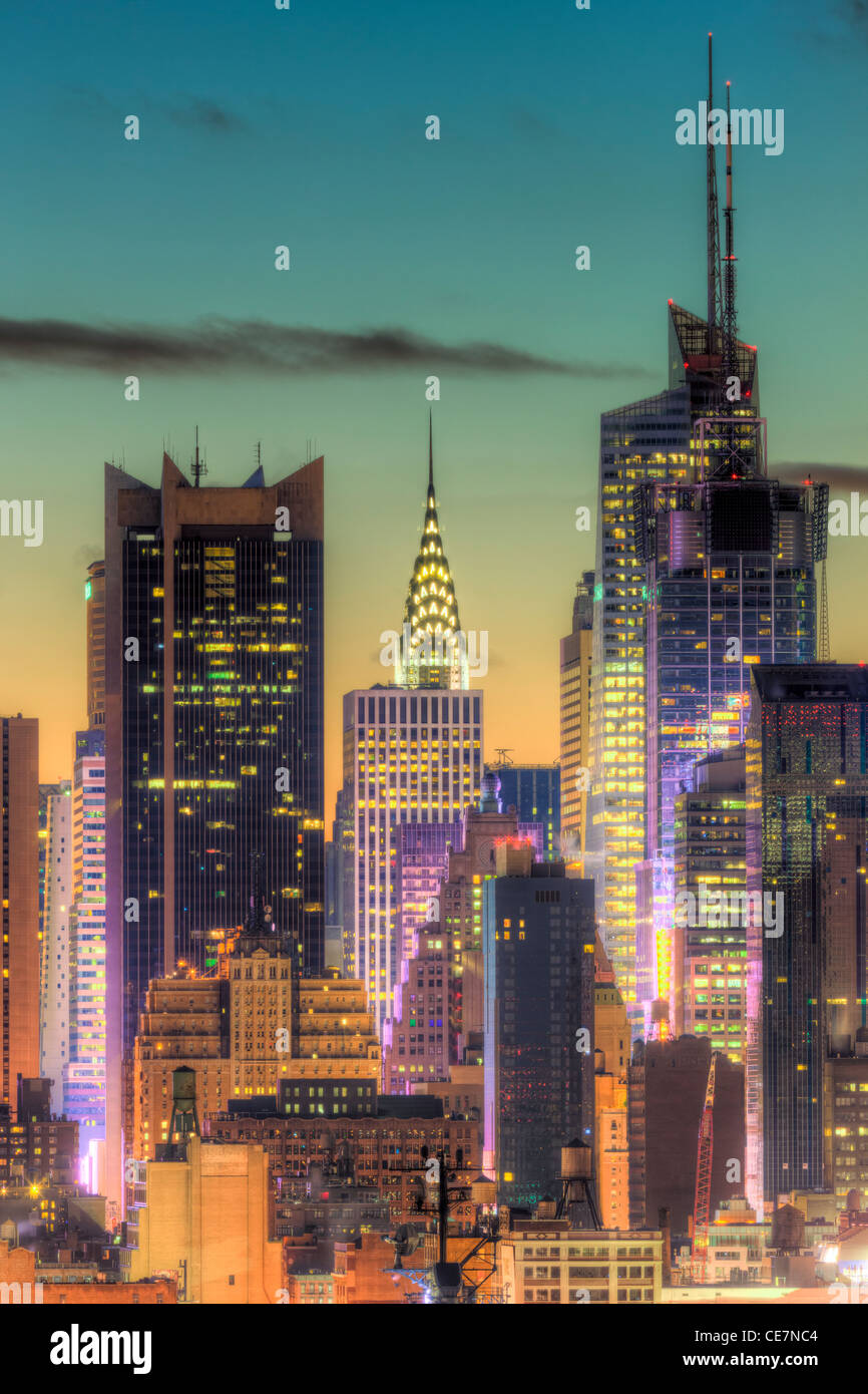 The Chrysler Building, Bank of America Tower, and other buildings near 42nd Street during morning twilight as viewed - Stock Image