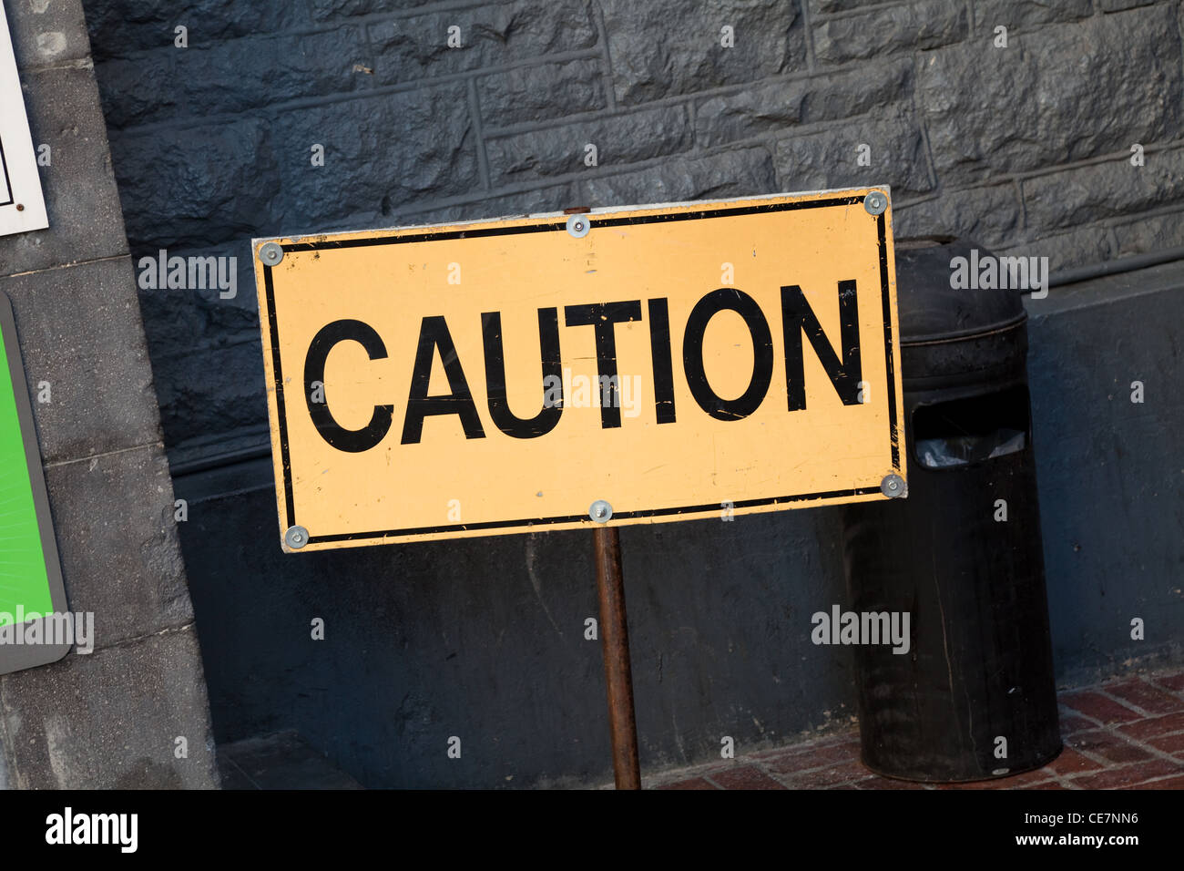 Yellow Caution sign close up - Stock Image