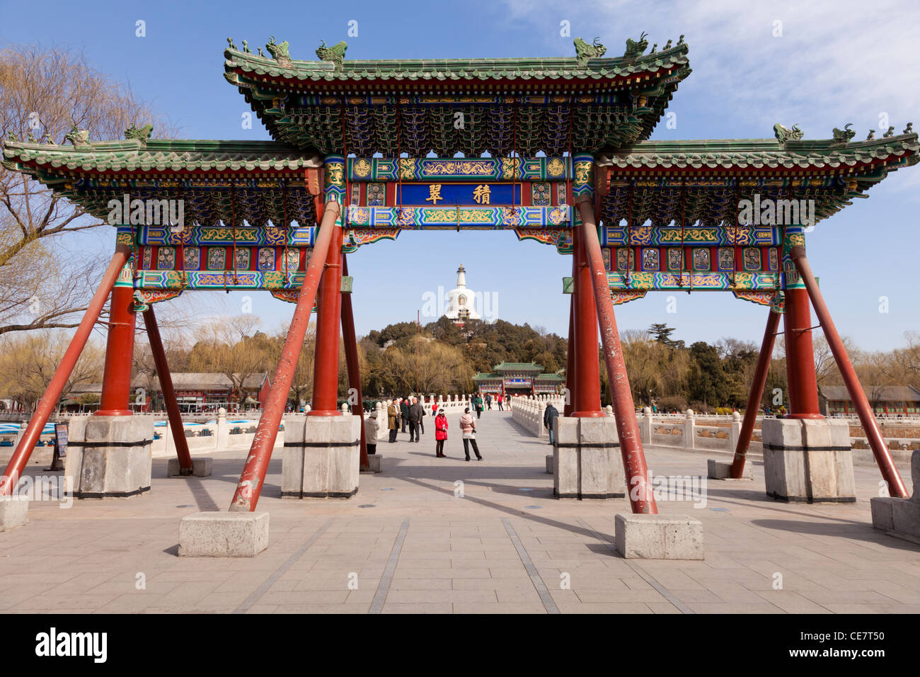 Entrance gate at Beihai Park, Beijing, China, with the White Pagoda behind. Stock Photo