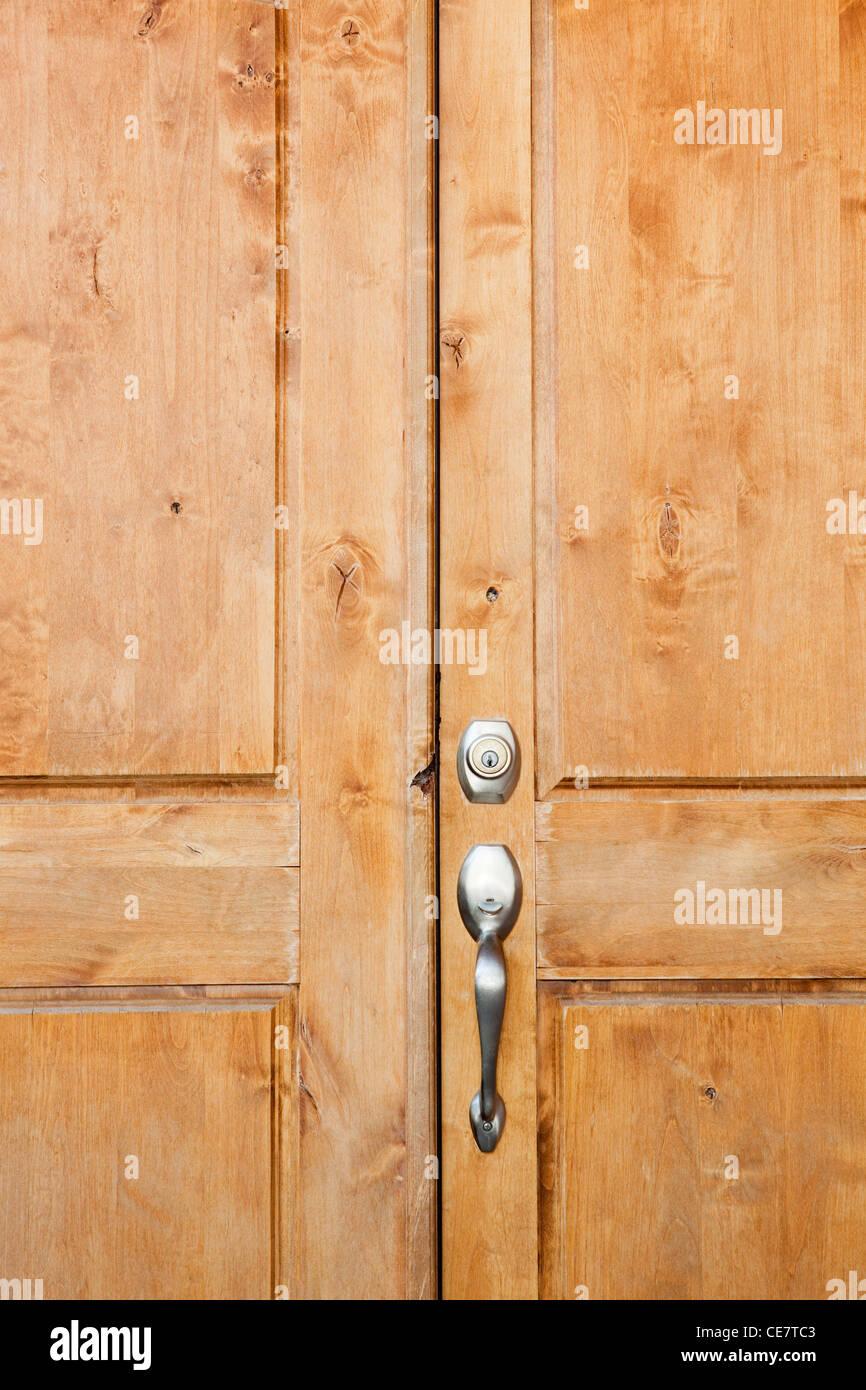 Wooden front door of home in Phoenix, Arizona - Stock Image