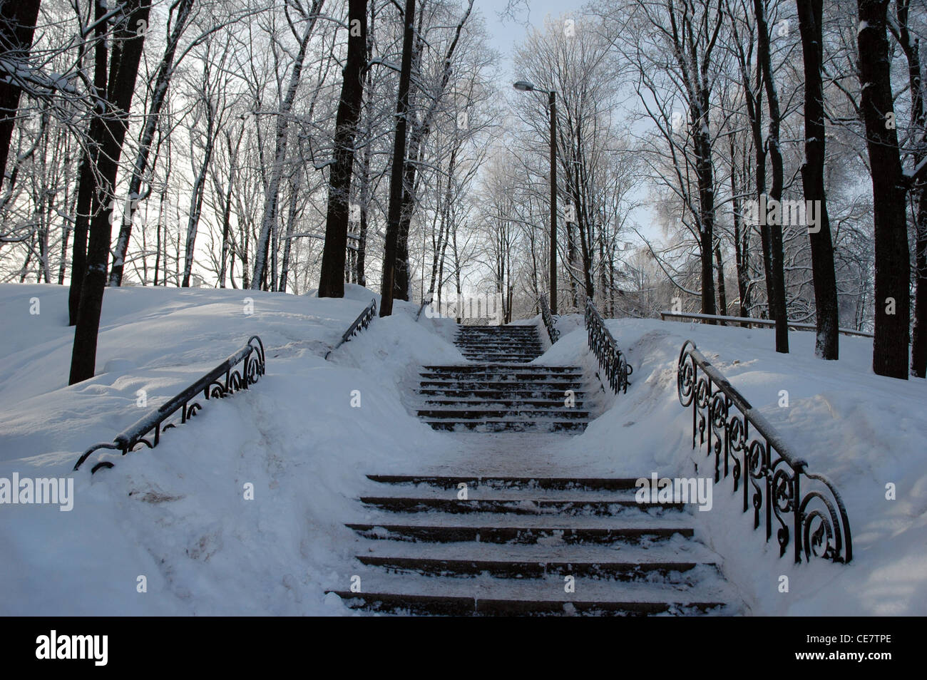 public park stair and handrail covered snow - Stock Image