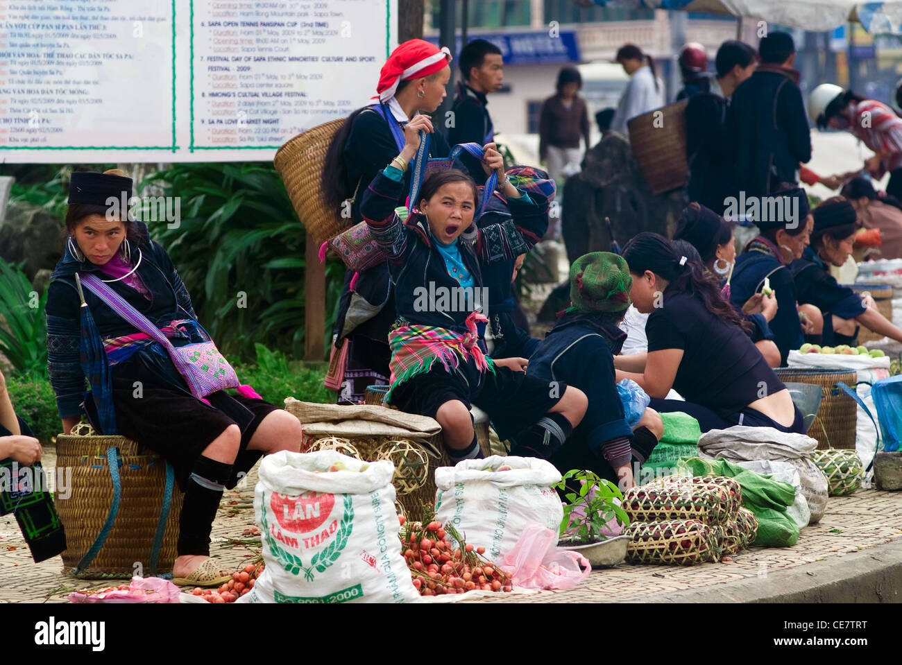 Hilltribe people sell their goods at the market  in Sapa, Vietnam. - Stock Image