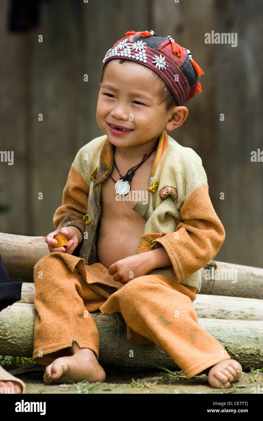A hilltribe boy is in front of his house in Sapa, Vietnam. - Stock Image