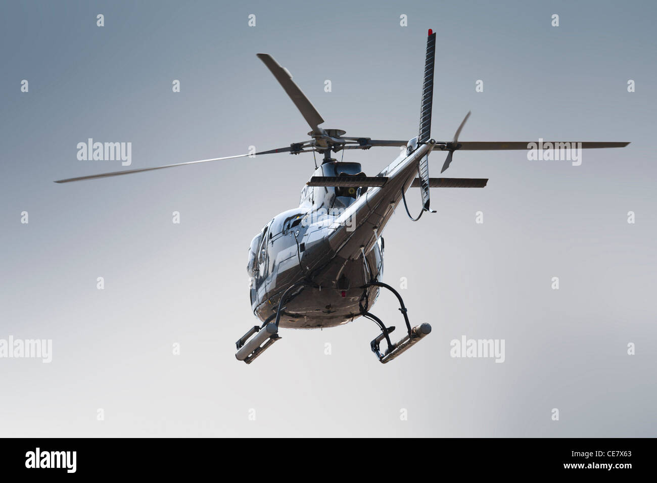 Backside of isolated helicopter Stock Photo