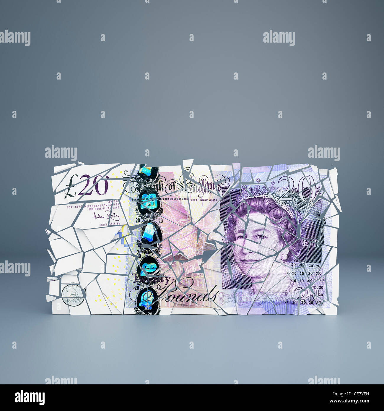 UK 20 pound note cracking up - representing debt crisis, fragility of the economy - Stock Image