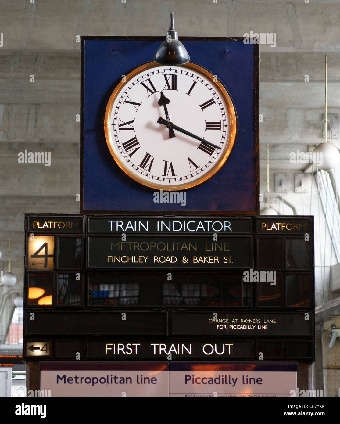 Clock and train indicator, Uxbridge Underground (Tube) station on the Metropolitan Line,  Middlesex, London, England - Stock Image