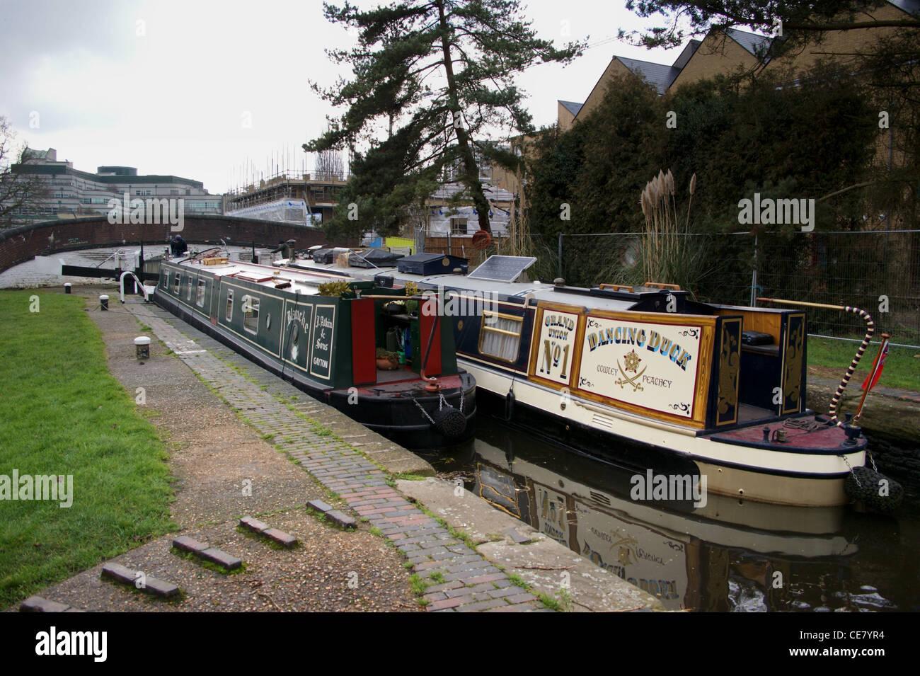 Narrowboats going down Uxbridge Lock, Grand Union Canal, Uxbridge, Hillingdon, London, England - Stock Image