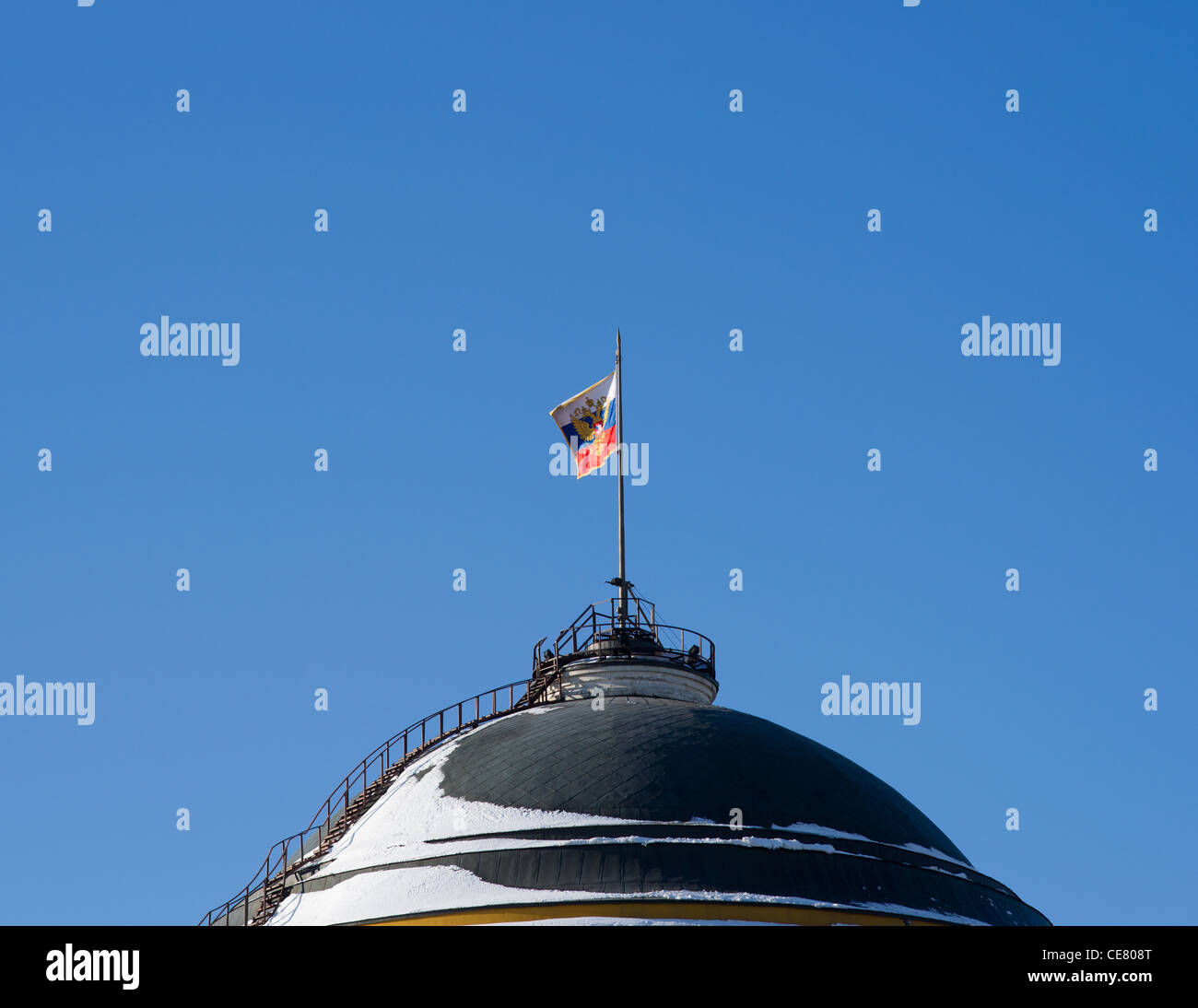 Standard of the President of the Russian Federation waving over the Senate building of Moscow Kremlin - Stock Image