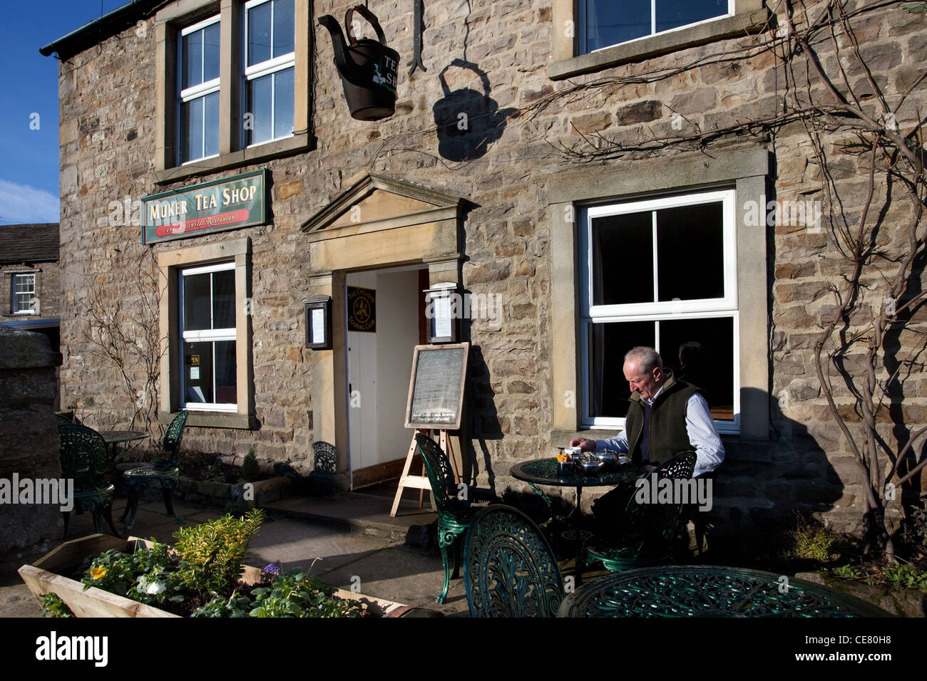Muker Tea Shop _ Village Catering with customer sat outside in the North Yorkshire Dales, UK - Stock Image