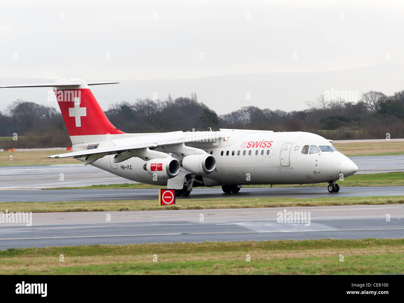 Swiss International Air Lines Bae Avro 146-RJ100 Airliner HB-IYZ Taxiing at Manchester International Airport England - Stock Image