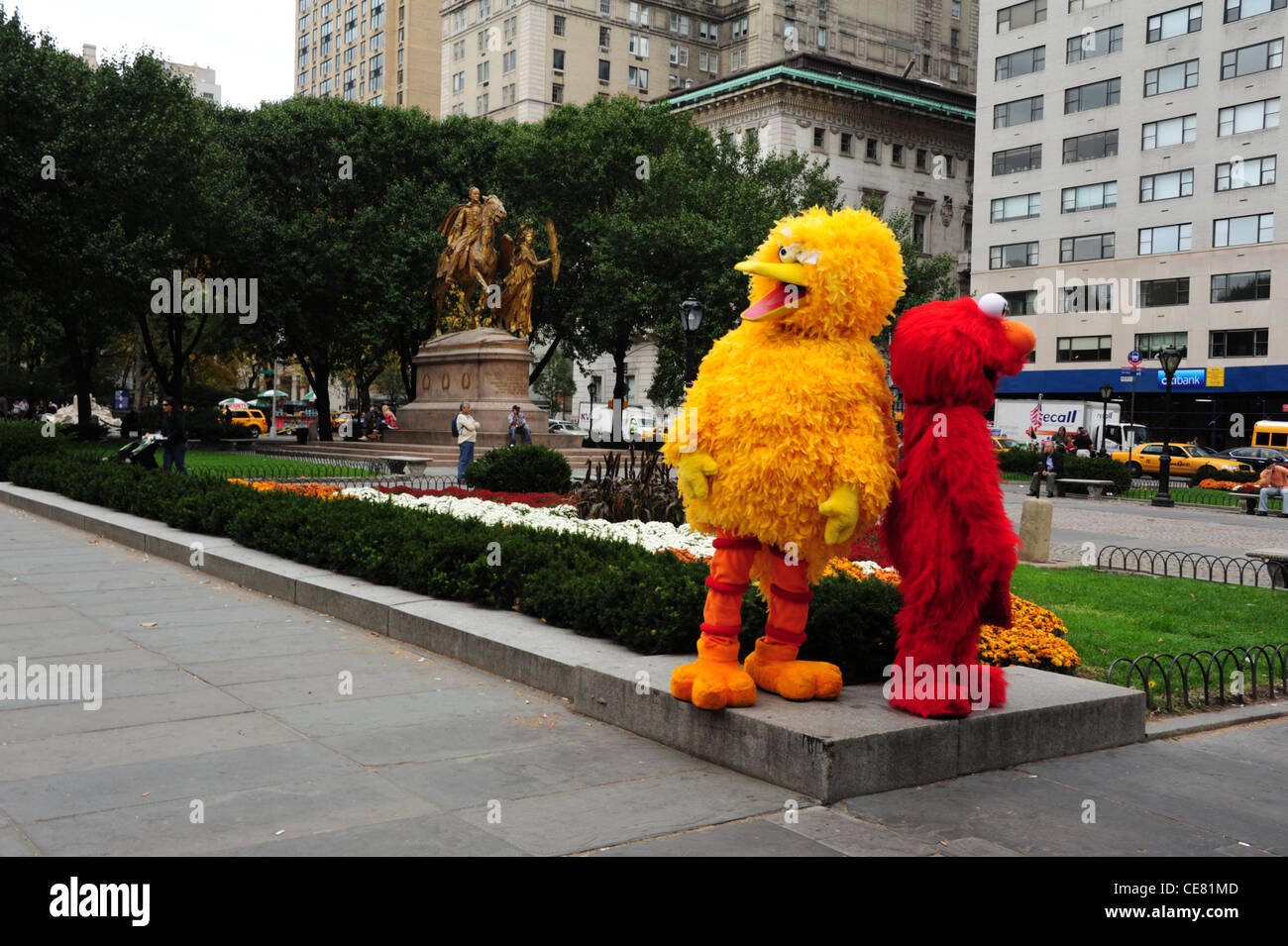 Two Sesame Street Big Bird Elmo Entertainers Posing Backdrop Green Trees Sherman Monument Grand Army Plaza New York