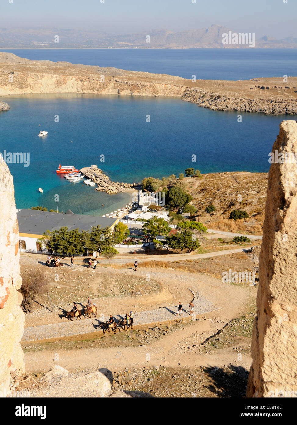 Looking down onto the bay at Lindos from the Acropolis - Stock Image