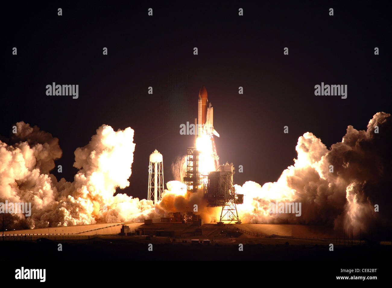 Space Shuttle Endeavour, on the STS-123 mission, lights up Launch Pad 39A and the night sky. Liftoff was on time - Stock Image