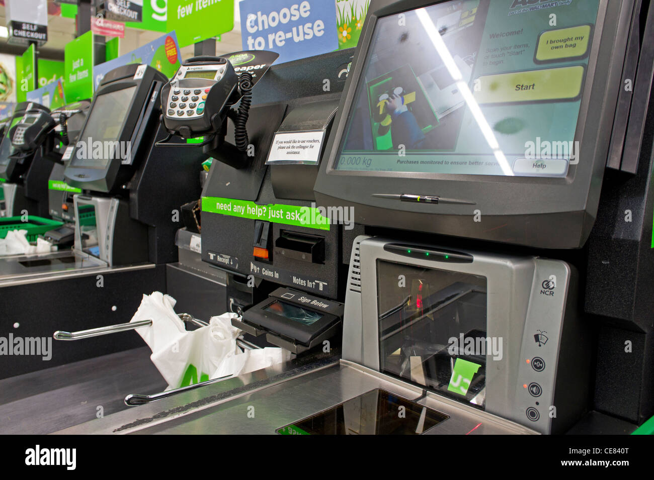 A self service check-out in an Asda store, UK - Stock Image