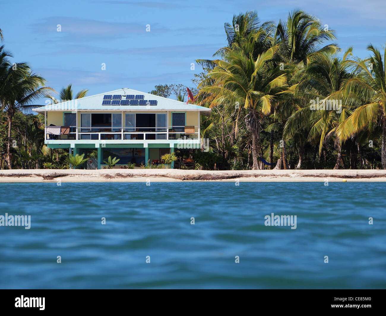 Off-grid beach house with coconuts trees, Caribbean sea, Panama, Central America - Stock Image