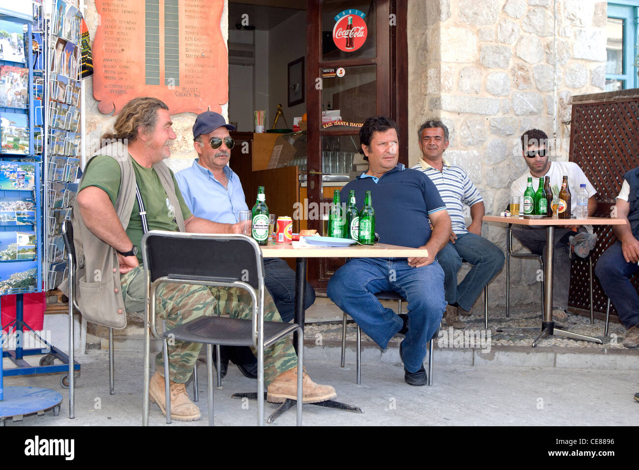 Ydra: locals relaxing with a beer - Stock Image