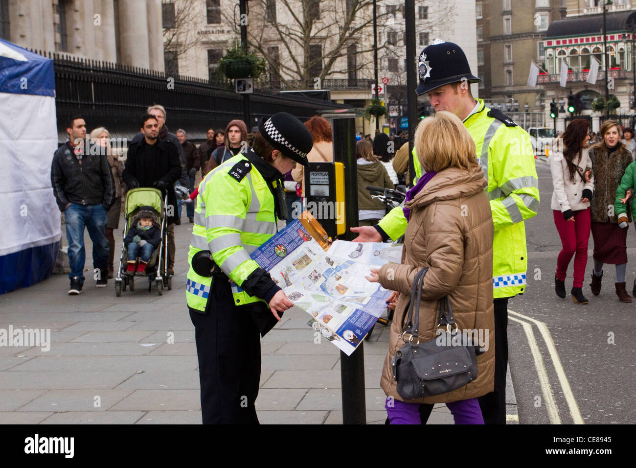 A lost tourist asking for directions from the police, London, England, UK - Stock Image