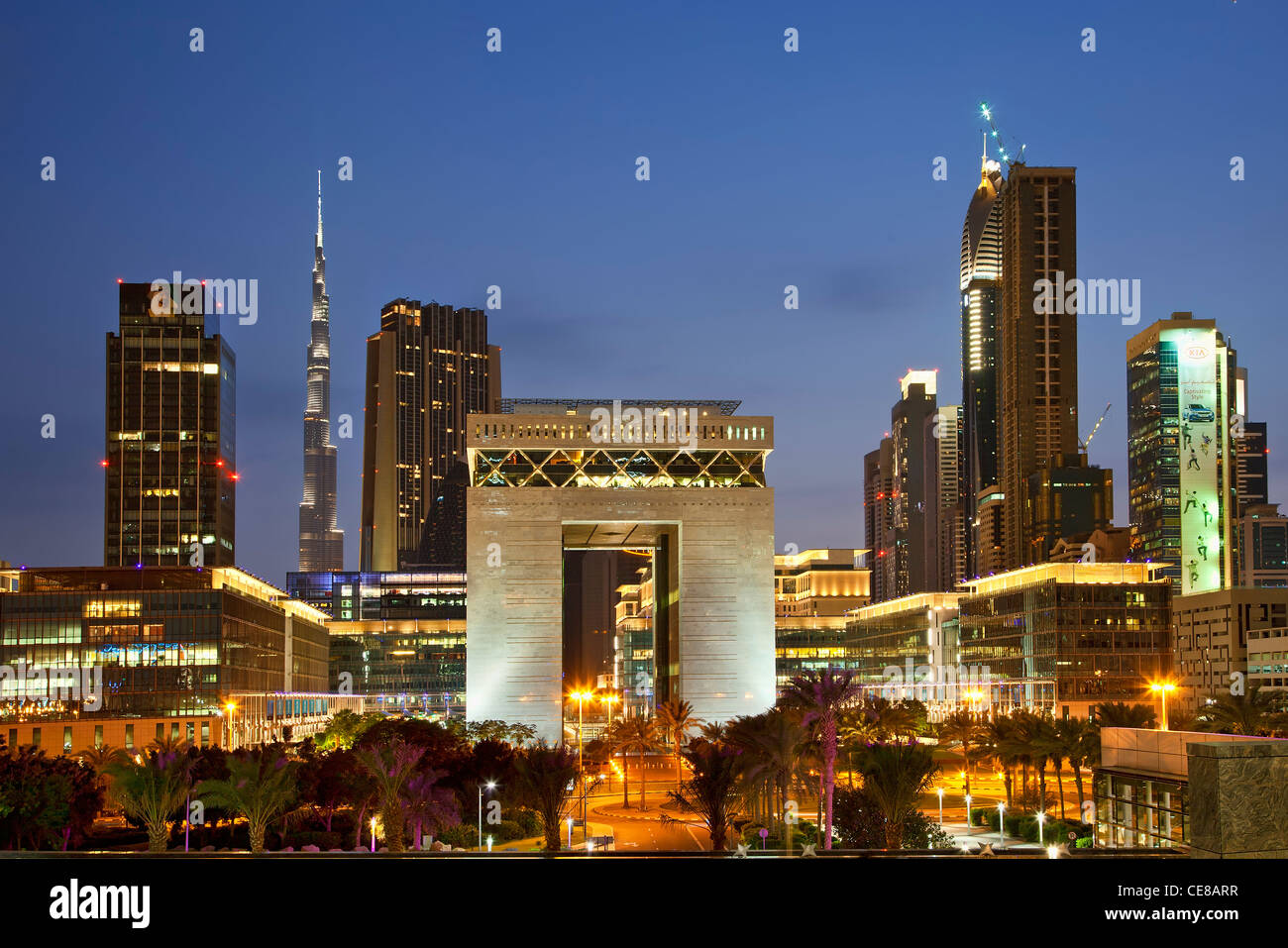 Asia, Arabia, Dubai Emirate, Dubai, Gate Building and Financial District at Dusk - Stock Image