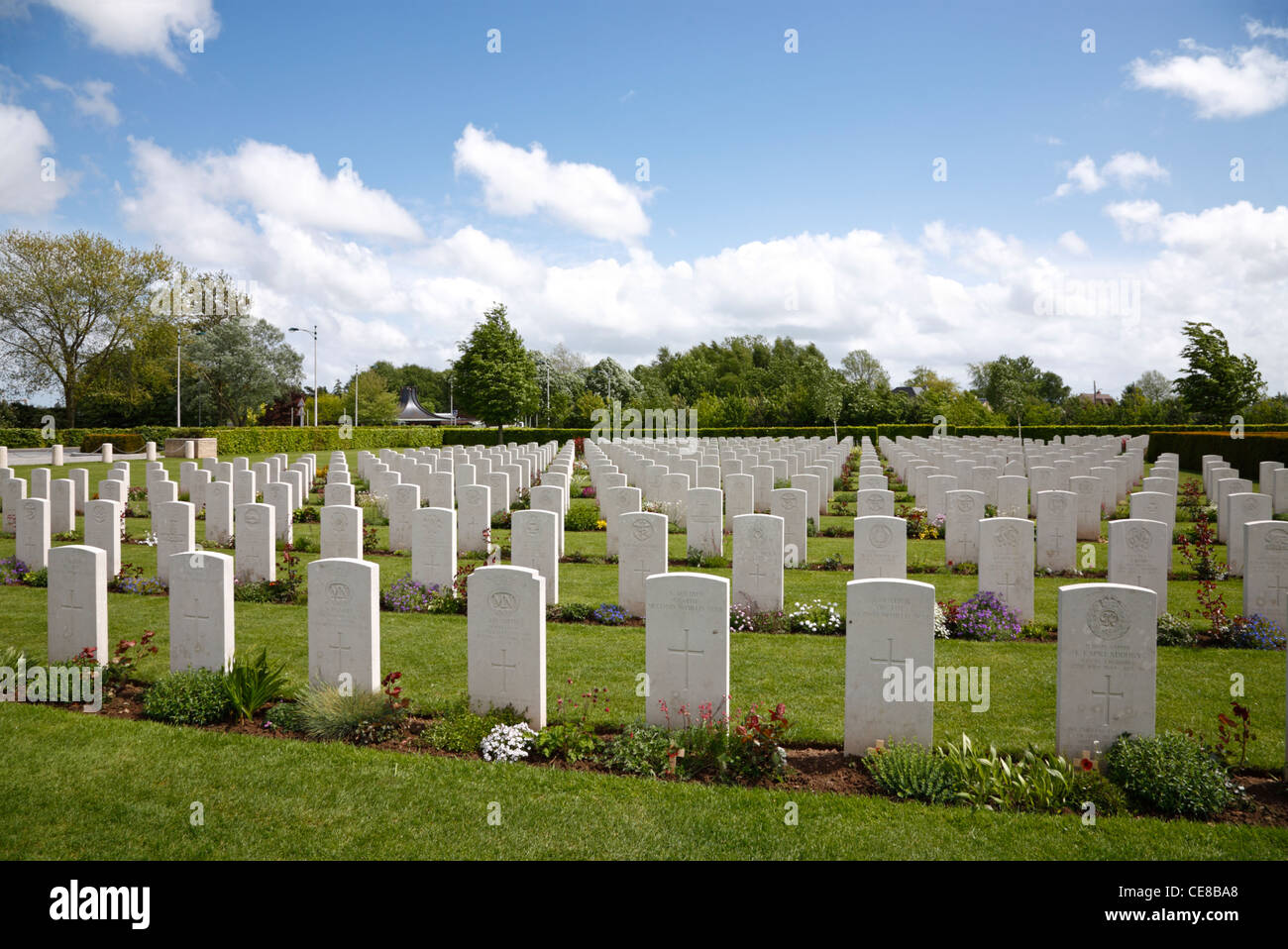 Graves and gravestones in the Bayeux War Cemetery - The British War Cemetery at Bayeux, Normandy, France. Commonwealth Stock Photo