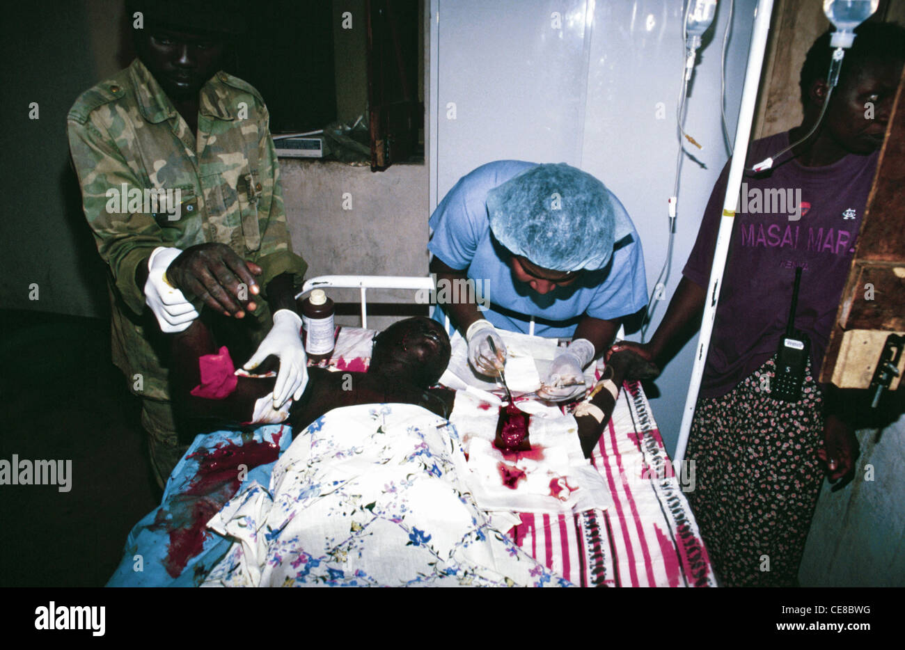 Shrapnel being extracted from a wounded soldier with no anaesthetic in Southern Sudan - Stock Image