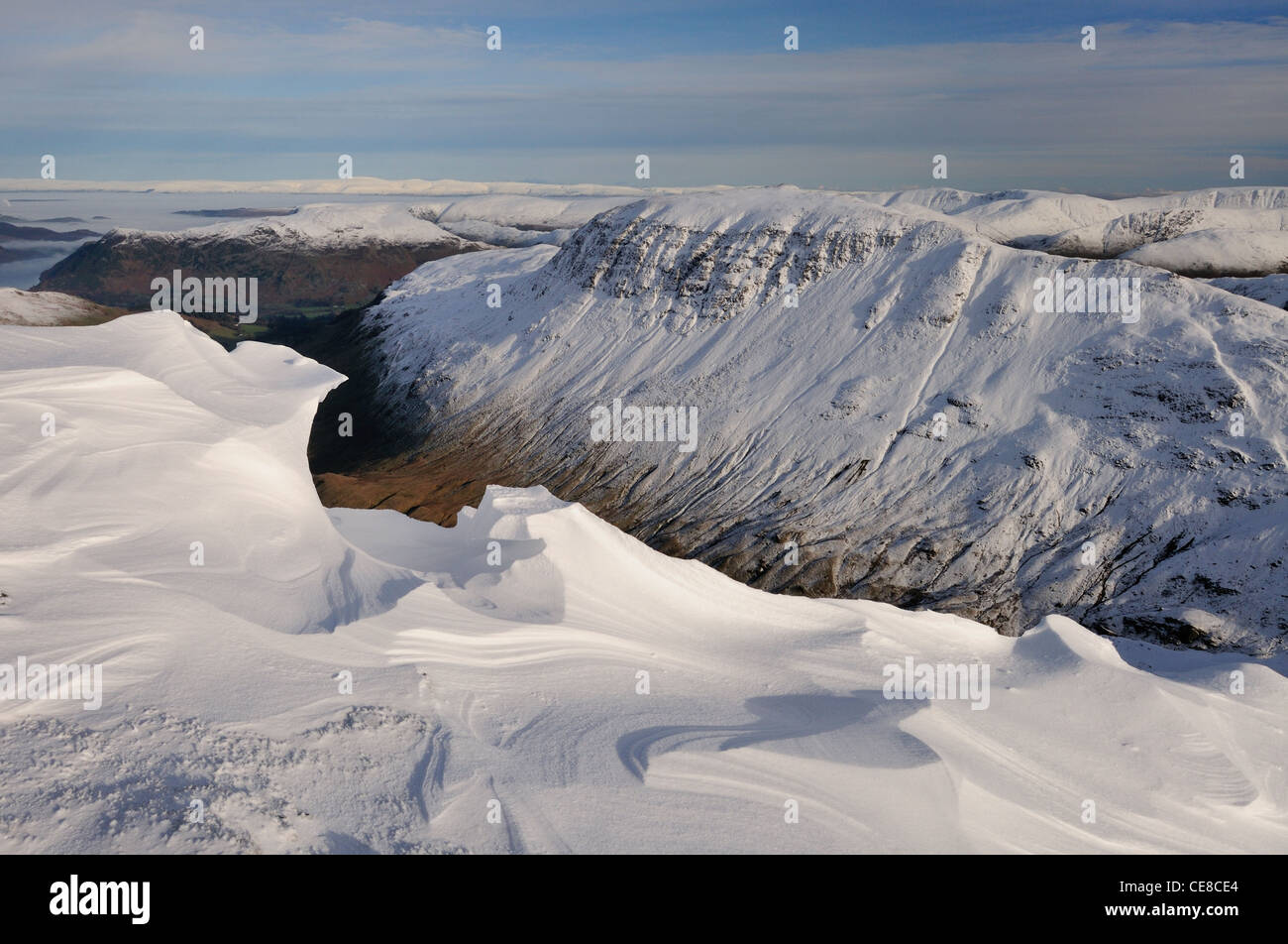 Sculpted cornices on Dollywaggon Pike looking over Grisedale Valley towards St Sunday Crag. Winter in the Lake District - Stock Image