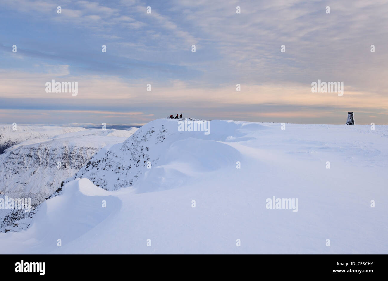 Wind sculpted cornice on the summit of Helvellyn in winter in the English Lake District - Stock Image