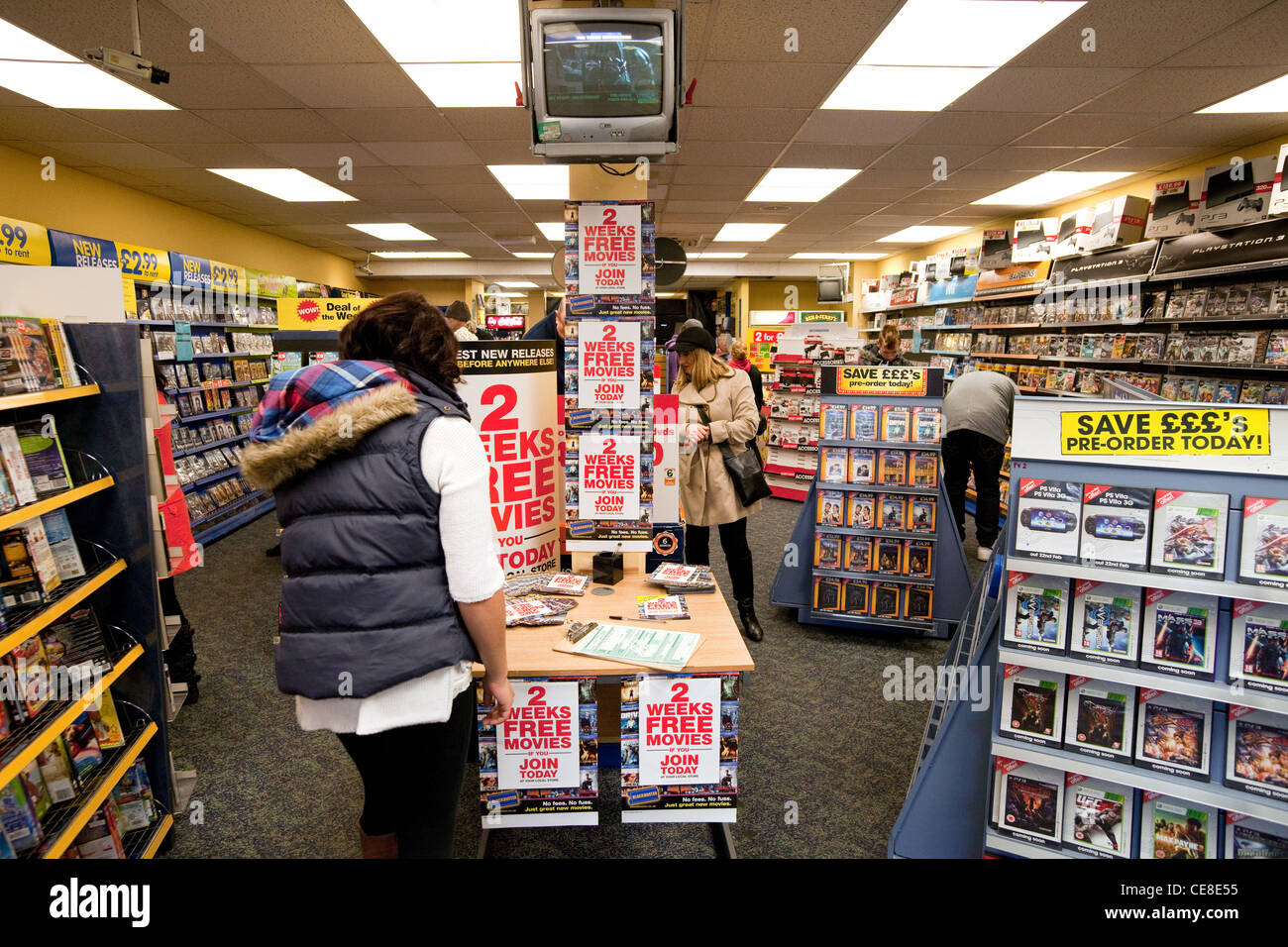 Teenage girl joining Blockbuster to rent movies, Newmarket  UK - Stock Image