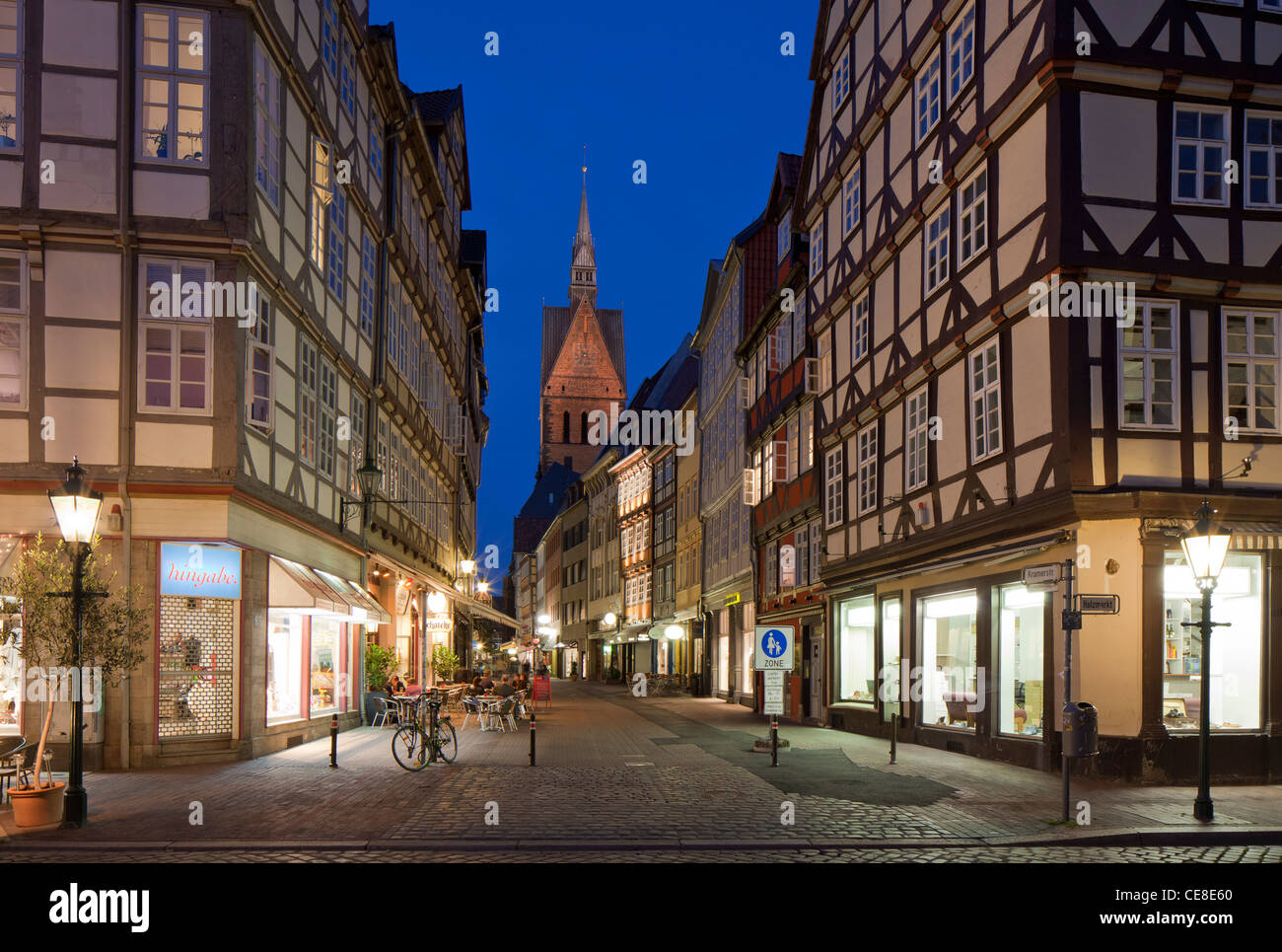 Kramerstraße with half-timbered houses and the Market Church / Marktkirche at night, Hannover, Germany - Stock Image