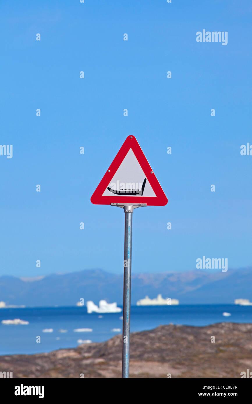 Warning sign for sledge dogs, Ilulissat, Jakobshavn, Disko-Bay, Greenland - Stock Image