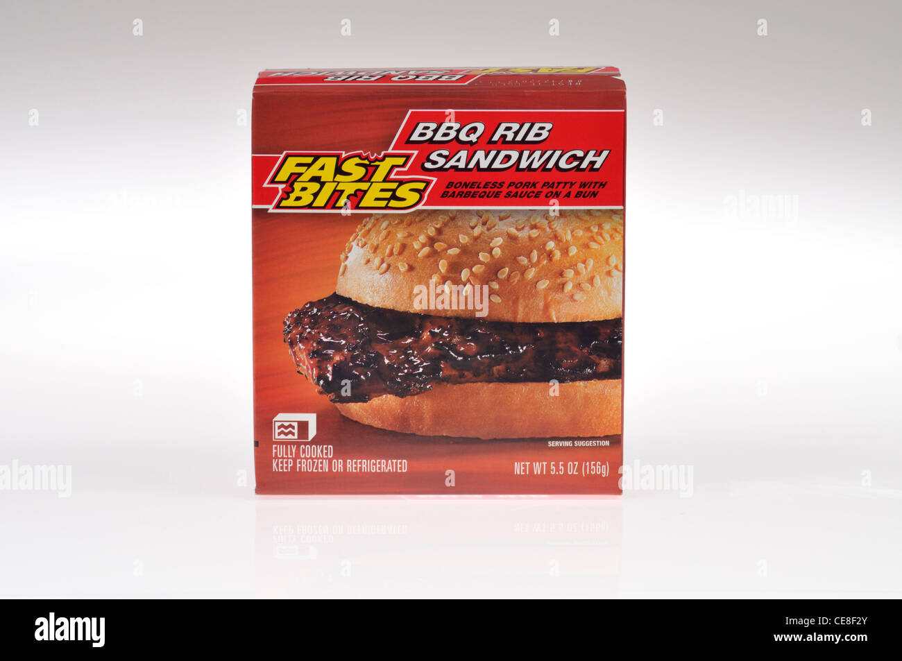 Microwave frozen Fast Bites BBQ rib sandwich in box on white background cutout - Stock Image