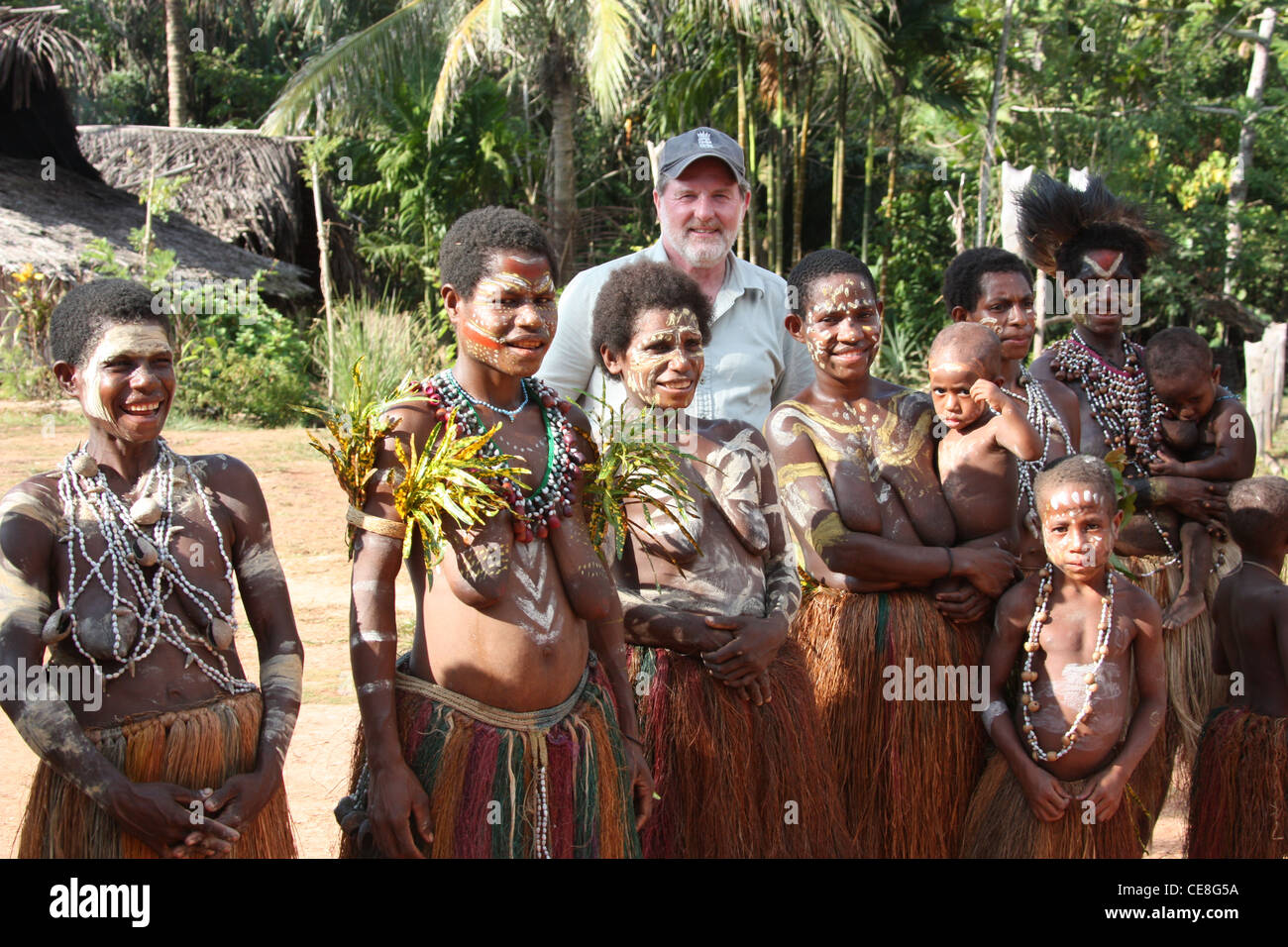 British Traveller visiting a remote village on the Karawari River in  Papua New Guinea - Stock Image