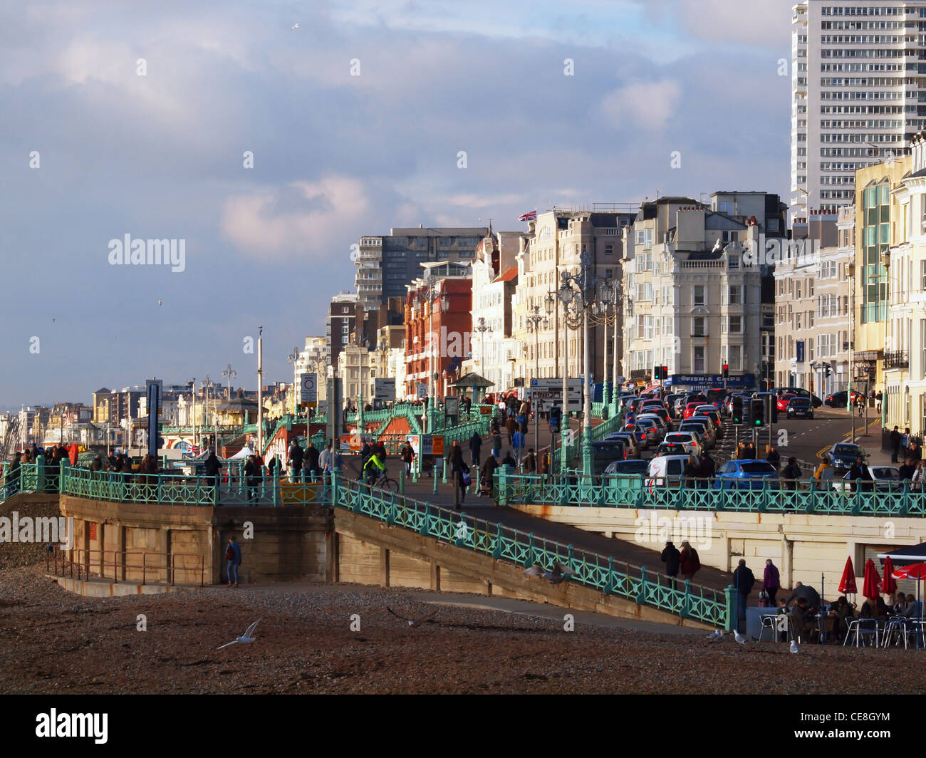 Brighton's busy sea front, with traffic driving into the city centre. - Stock Image