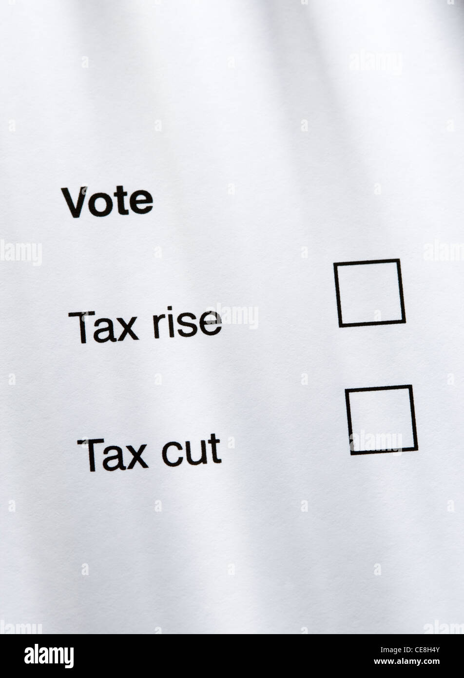 Tax rise or tax cut concept. - Stock Image