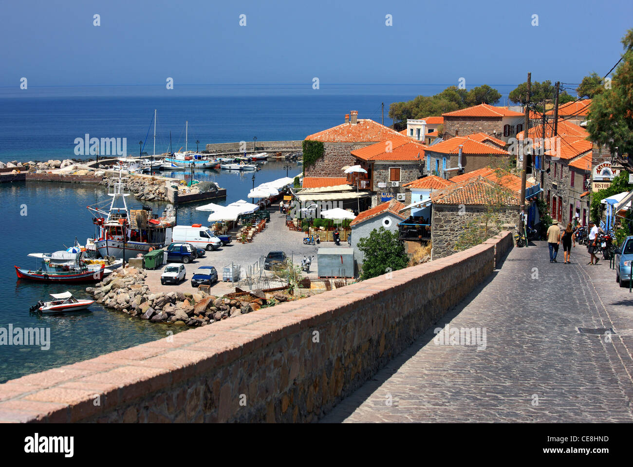 The road that leads to the picturesque little harbor of Molyvos town, Lesvos island, Northern Aegean, Greece. - Stock Image