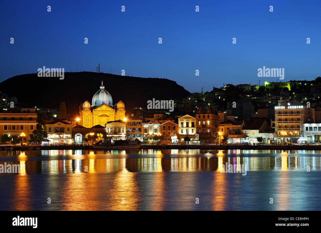 Partial night view of the port of Mytilene town, capital of Lesvos island, Northern Aegean, Greece. - Stock Image